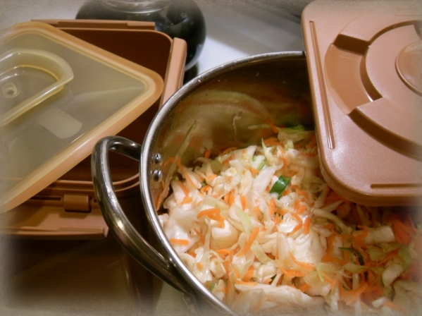 Japanese pickling box for kimchi, here with sauerkraut to be.